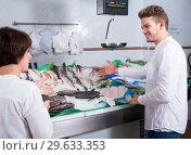 Купить «Cheerful customers choosing seafood in store», фото № 29633353, снято 25 октября 2016 г. (c) Яков Филимонов / Фотобанк Лори