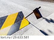 Купить «Road barrier with yellow and black striped caution pattern», фото № 29633581, снято 23 июня 2018 г. (c) FotograFF / Фотобанк Лори