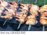 Купить «Appetizing shashlik from chicken meat on metal skewers», фото № 29633593, снято 30 июня 2018 г. (c) FotograFF / Фотобанк Лори