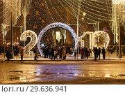 Moscow, Russia -January 2. 2019. 2019 - light installation on a Lubyanka Square. Редакционное фото, фотограф Володина Ольга / Фотобанк Лори