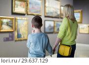 Купить «Mother and son regarding paintings in halls of museum», фото № 29637129, снято 18 марта 2017 г. (c) Яков Филимонов / Фотобанк Лори