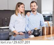 Купить «Loving couple in kitchen», фото № 29637201, снято 24 мая 2018 г. (c) Яков Филимонов / Фотобанк Лори