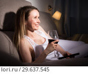 Girl is resting with wine and watching TV. Стоковое фото, фотограф Яков Филимонов / Фотобанк Лори