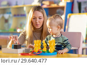 Preschool child, playing with toys in a sunny room, kid development. Стоковое фото, фотограф Оксана Кузьмина / Фотобанк Лори