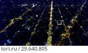 Купить «Aerial view of illuminated Eixample district in Barcelona at night, Spain», видеоролик № 29640805, снято 16 ноября 2018 г. (c) Яков Филимонов / Фотобанк Лори