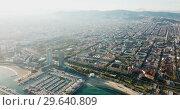Купить «Aerial view of seaside area of Barcelona with harbor on sunny day, Catalonia, Spain», видеоролик № 29640809, снято 16 ноября 2018 г. (c) Яков Филимонов / Фотобанк Лори