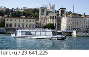 Купить «View of Cathedral of Saint-Jean and Notre Dame Basilica on Fourviere hill on bank of river Saone in Lyon, France», видеоролик № 29641225, снято 12 октября 2018 г. (c) Яков Филимонов / Фотобанк Лори