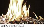 Купить «Bunch of burning fifty dollar bills rotate on a black background close-up», видеоролик № 29644693, снято 29 декабря 2018 г. (c) Алексей Кузнецов / Фотобанк Лори