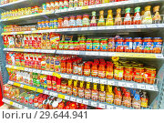 Купить «Russia, Samara, November 2018: a variety of sauces in a large supermarket. Text in Russian: ketchup, lecho, kukhmaster, Fry meat, sauce, spicy, Sloboda», фото № 29644941, снято 30 ноября 2018 г. (c) Акиньшин Владимир / Фотобанк Лори