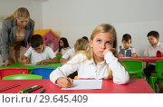 Купить «Portrait of bored schoolgirl», фото № 29645409, снято 26 марта 2019 г. (c) Яков Филимонов / Фотобанк Лори