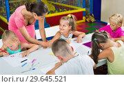 Купить «Kids drawing together with tutor at hobby group», фото № 29645521, снято 23 февраля 2020 г. (c) Яков Филимонов / Фотобанк Лори