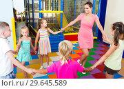 Купить «children dancing with teacher to music in class at school», фото № 29645589, снято 14 декабря 2019 г. (c) Яков Филимонов / Фотобанк Лори