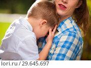 Купить «Mother holds in her arms a little tired boy», фото № 29645697, снято 10 ноября 2017 г. (c) Pavel Biryukov / Фотобанк Лори