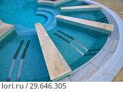 Купить «Descent to the pool made in shape of a semicircle», фото № 29646305, снято 3 ноября 2018 г. (c) Володина Ольга / Фотобанк Лори