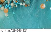 Купить «Colorful paint in bubbles organically moves in the liquid», видеоролик № 29646821, снято 5 июля 2020 г. (c) Dzmitry Astapkovich / Фотобанк Лори