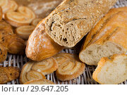 Купить «Cut wholegrain baguette with bakery products», фото № 29647205, снято 30 января 2018 г. (c) Яков Филимонов / Фотобанк Лори