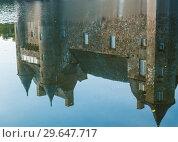 Купить «Reflection in the pond of the turrets  of the 14th century Chateau de Trecesson», фото № 29647717, снято 18 сентября 2017 г. (c) Николай Коржов / Фотобанк Лори