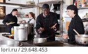 Купить «Chef male dissatisfied with the work of girl helper», фото № 29648453, снято 5 декабря 2018 г. (c) Яков Филимонов / Фотобанк Лори