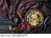 Купить «Kedgeree in a clay bowl. flat lay», фото № 29649077, снято 25 декабря 2018 г. (c) Oksana Zh / Фотобанк Лори
