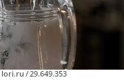 Купить «Close-up Of A Barman Pours Bubbly Water Into A Decanter», видеоролик № 29649353, снято 16 июля 2020 г. (c) Pavel Biryukov / Фотобанк Лори
