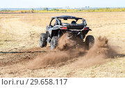 Купить «Four wheel sports drive ATV vehicle rushes on the rural road», фото № 29658117, снято 22 сентября 2018 г. (c) FotograFF / Фотобанк Лори