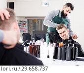 Купить «male hairdresser doing haircut for male client at hair salon», фото № 29658737, снято 27 января 2017 г. (c) Яков Филимонов / Фотобанк Лори
