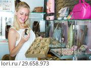 Купить «girl choosing bracelet in bijouterie shop», фото № 29658973, снято 26 марта 2019 г. (c) Яков Филимонов / Фотобанк Лори