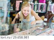 Купить «Woman customer looking fashion bracelet», фото № 29658981, снято 16 июля 2019 г. (c) Яков Филимонов / Фотобанк Лори