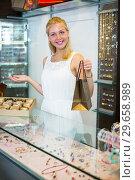 Купить «Female seller standing in jewellery boutique», фото № 29658989, снято 22 марта 2019 г. (c) Яков Филимонов / Фотобанк Лори
