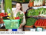 Купить «Portrait of woman who is standing with basket with fruits in the market.», фото № 29659021, снято 26 мая 2018 г. (c) Яков Филимонов / Фотобанк Лори