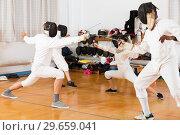 Купить «Young fencers training with coach», фото № 29659041, снято 30 мая 2018 г. (c) Яков Филимонов / Фотобанк Лори