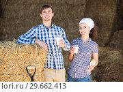 Купить «man and woman in hay with milk», фото № 29662413, снято 22 марта 2019 г. (c) Яков Филимонов / Фотобанк Лори