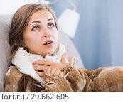 Купить «Sick girl with scarf on neck», фото № 29662605, снято 24 июня 2017 г. (c) Яков Филимонов / Фотобанк Лори