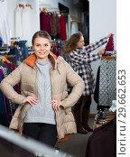 Купить «Woman standing in overcoat in boutique», фото № 29662653, снято 6 декабря 2018 г. (c) Яков Филимонов / Фотобанк Лори