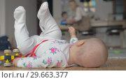 Купить «Eight months baby girl playing with toy at home», видеоролик № 29663377, снято 24 июня 2019 г. (c) Данил Руденко / Фотобанк Лори