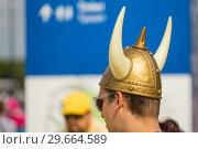 Купить «Russia, Samara, July 2018: a young Swedish fan wearing a helmet with horns at the World Championships.», фото № 29664589, снято 7 июля 2018 г. (c) Акиньшин Владимир / Фотобанк Лори