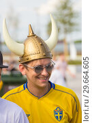 Купить «Russia, Samara, July 2018: a young Swedish fan wearing a helmet with horns at the World Championships.», фото № 29664605, снято 7 июля 2018 г. (c) Акиньшин Владимир / Фотобанк Лори
