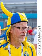 Купить «Russia, Samara, July 2018: a young Swedish fan wearing a helmet with horns at the World Championships.», фото № 29664621, снято 7 июля 2018 г. (c) Акиньшин Владимир / Фотобанк Лори