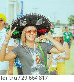 Купить «Russia, Samara, July 2018: beautiful Mexican football fan during the FIFA 2018 World Cup.», фото № 29664817, снято 2 июля 2018 г. (c) Акиньшин Владимир / Фотобанк Лори
