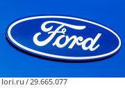 Купить «Dealership sign Ford on the office of official dealer», фото № 29665077, снято 24 февраля 2018 г. (c) FotograFF / Фотобанк Лори