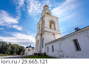 Купить «Bell tower of the St. George (Yuriev) Orthodox Male Monastery in summer day», фото № 29665121, снято 17 августа 2017 г. (c) FotograFF / Фотобанк Лори