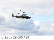 Купить «Russian Air Force Mi-28 Havoc military attack combat helicopter in camouflage flying against cloudy sky», фото № 29665129, снято 10 сентября 2017 г. (c) FotograFF / Фотобанк Лори