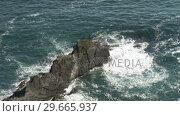 Купить «Waves Crashing against the Cliffs», видеоролик № 29665937, снято 23 мая 2019 г. (c) Wavebreak Media / Фотобанк Лори