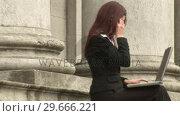 Купить «Businesswoman Working outdoors», видеоролик № 29666221, снято 15 февраля 2008 г. (c) Wavebreak Media / Фотобанк Лори