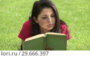 Купить «Woman Reading Outdoors», видеоролик № 29666397, снято 26 февраля 2008 г. (c) Wavebreak Media / Фотобанк Лори