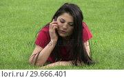 Купить «Woman Lying on Grass», видеоролик № 29666401, снято 26 февраля 2008 г. (c) Wavebreak Media / Фотобанк Лори