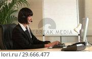 Купить «Business Woman Talking on Headset», видеоролик № 29666477, снято 1 марта 2008 г. (c) Wavebreak Media / Фотобанк Лори