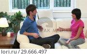 Купить «Young Couple on Sofa Arguing», видеоролик № 29666497, снято 1 марта 2008 г. (c) Wavebreak Media / Фотобанк Лори