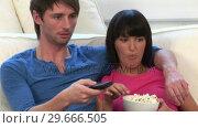 Купить «Young Couple Watching Television», видеоролик № 29666505, снято 1 марта 2008 г. (c) Wavebreak Media / Фотобанк Лори