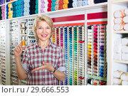 Купить «mature woman in sewing store», фото № 29666553, снято 22 марта 2019 г. (c) Яков Филимонов / Фотобанк Лори